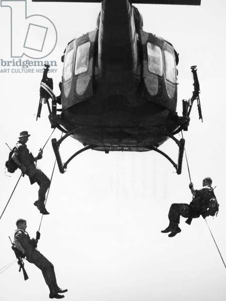 VIETNAM WAR: HELICOPTER Troopers of the 173rd Airborne Brigade rappel from a helicopter in South Vietnam, December 1966.