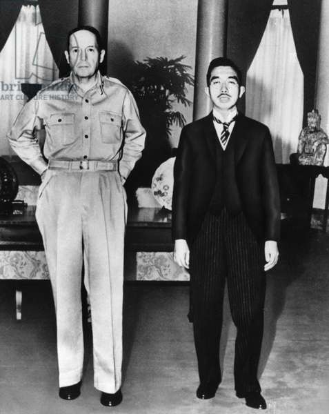 HIROHITO AND MACARTHUR Hirohito, Emperor of Japan 1926-1989, photographed with American General Douglas MacArthur in Tokyo, Japan, 1945.