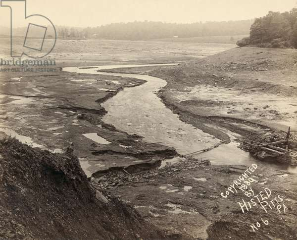 JOHNSTOWN FLOOD, 1889 Bed of Lake Conemaugh, looking from top of the broken South Fork Dam, after the Johnstown Flood. Photograph by Ernest Walter Histed, 1889.