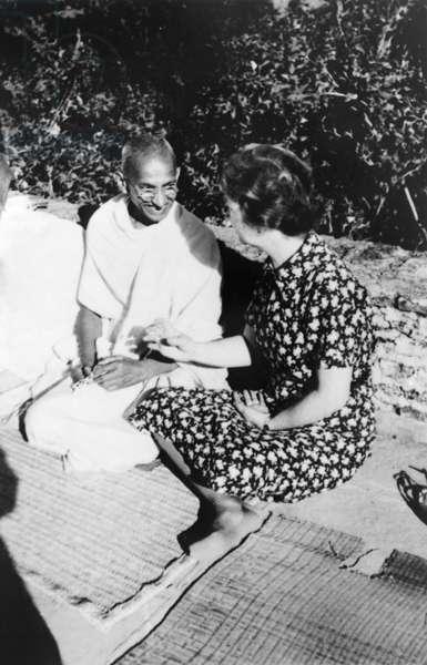 MARGARET SANGER (1879-1966) American birth control activist, sex educator, and nurse. Photographed with Mahatma Gandhi, February 1936.