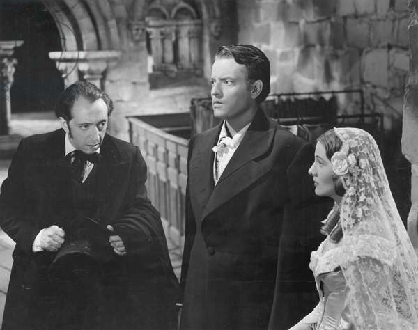 ORSON WELLES (1915-1985) John Abbott, Orson Welles and Joan Fontaine in a scene from the motion picture production of Jane Eyre, 1944.