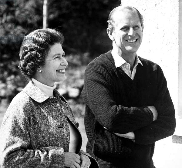 ELIZABETH II (1926-) Queen of Great Britain, 1952-. With her husband Prince Philip, Duke of Edinburgh, in 1972, on the grounds of Balmoral Castle.