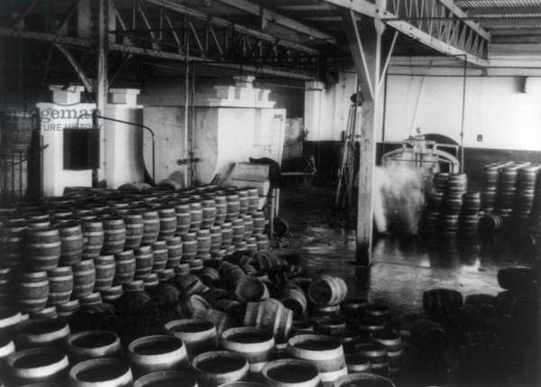 MOONSHINE, 1920s Barrels of moonshine whiskey inside a warehouse during Prohibition in America, 1920s.