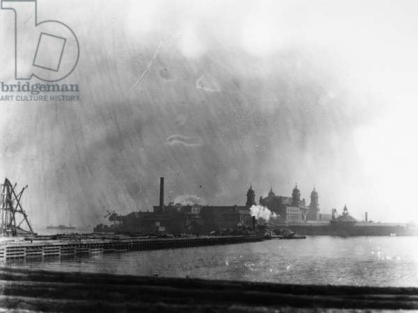 ELLIS ISLAND, 1912 The immigration station in New York Harbor photographed from New Jersey, looking across Morris Canal, 1912.