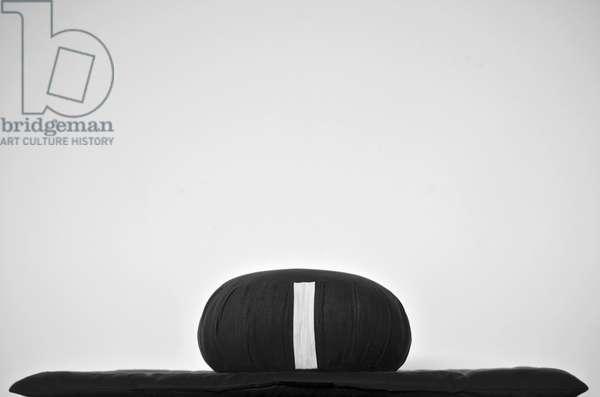 An empty meditation cushion (Zafu) (b/w photo)