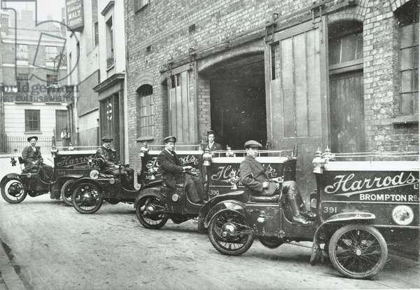 Delivery men wait outside Harrod's Stores , 1925 (b/w photo)