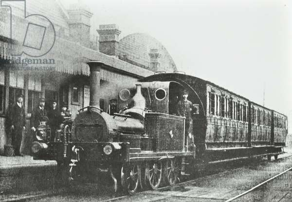 South Dock Station: a four wheel coupled tank locomotive at the station, 1880 (b/w photo)