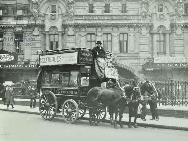 Horse-drawn omnibus at Victoria Station, 1911 (b/w photo)
