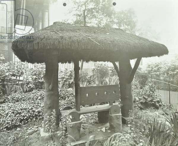 Saint Johns Church: stocks in churchyard, 1920 (b/w photo)