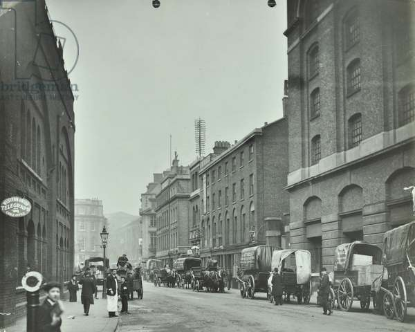 Tooley Street with horses and carts, London, 1915 (b/w photo)