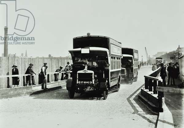 Buses being used to test structure at Waterloo Bridge, 1925 (b/w photo)