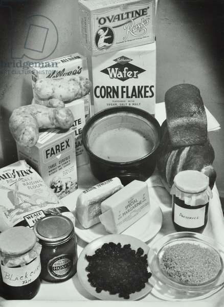Food provided by the institution: Ovaltine, Corn Flakes, Bread and Honey, Day Nursery, Old Church Road, 1957 (b/w photo)