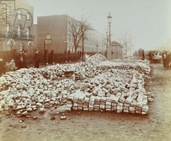 Coborn Road: building materials deposited by Stepney Borough Council, 1907 (b/w photo)