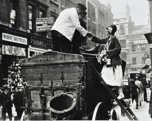 Dustmen receiving flowers on Alexandra Rose Day, London, 1924 (b/w photo)