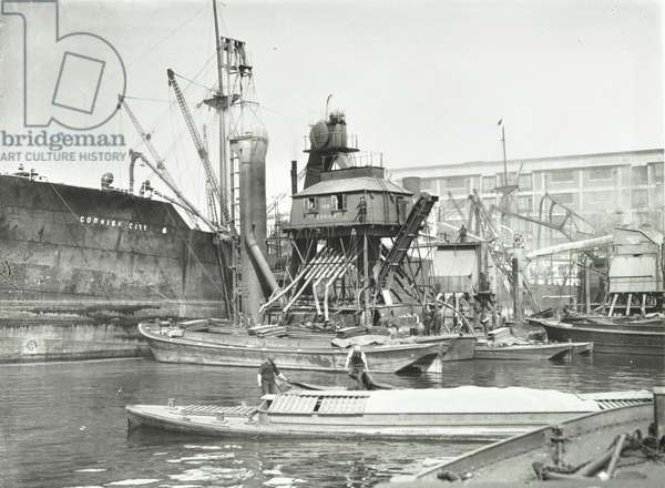Victoria Dock with workers on various vessels, including the 'Cornish City', London, 1938 (b/w photo)