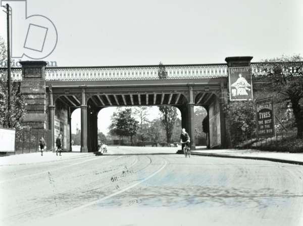 Lordship Lane: by Wood Vale looking south to railway bridge, London, 1925 (b/w photo)