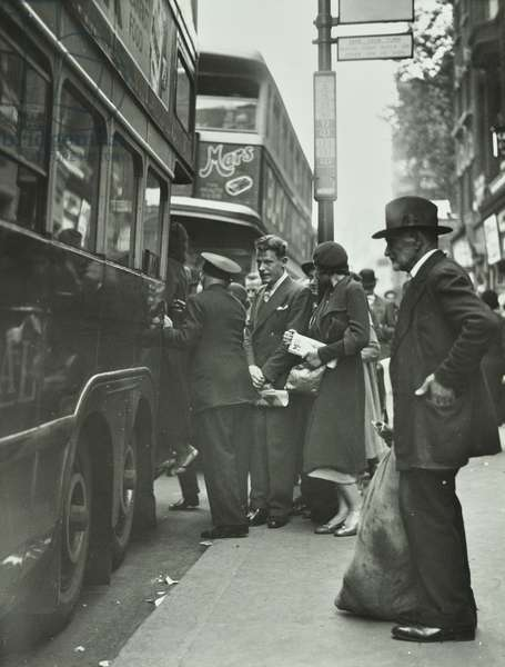 Buses and bus queue in Whitechapel High Street, 1930 (b/w photo)