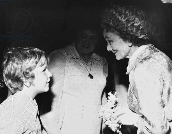 The Duchess of Gloucester converses with a pupils on her visit to St Paul's Church of England School, 11th July 1973 (b/w photo)
