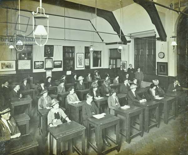 Classroom of William Street School, Hammersmith with men and women at their desks, London, 1913 (b/w photo)