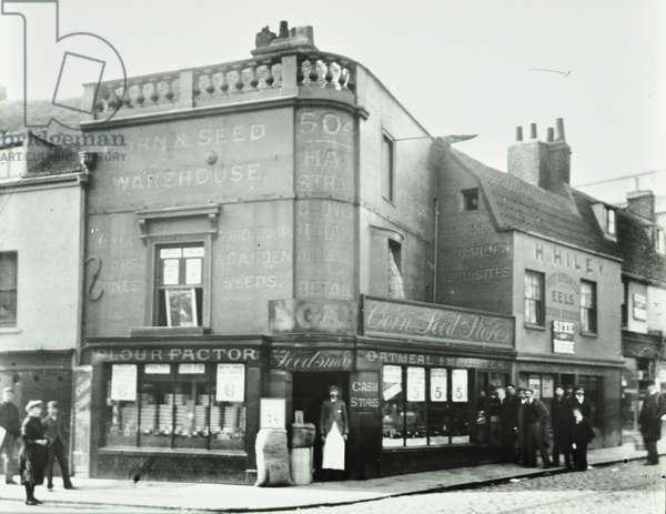 Deptford Broadway: street scene with shop fronts, London, 1897 (b/w photo)