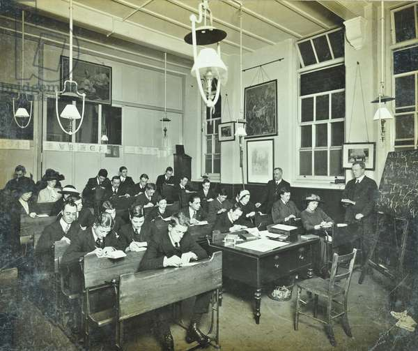 Classroom of William Street School, Hammersmith, with men and women taking shorthand notes, London, 1913 (b/w photo)