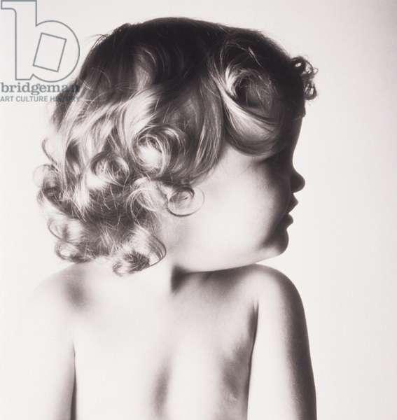 Baby girl (2-3) posing in studio
