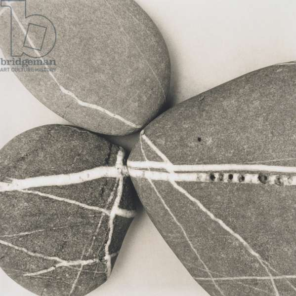 Composition of pebbles with white lines,