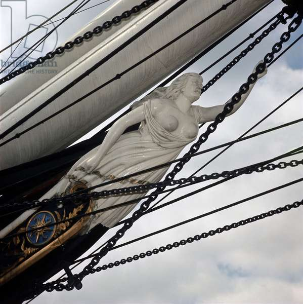 Figure of the clipper Cutty Sark depicting the witch with her arm stretched to catch the tail of the mare Nannie. Greenwich Cutty Sark.