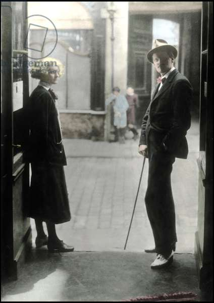 James Joyce posing on Shakespeare and Company bookshop (Rue de l'odeon) doorstep along with the owner of the bookshop, Sylvia Beach. Paris, 1920s.