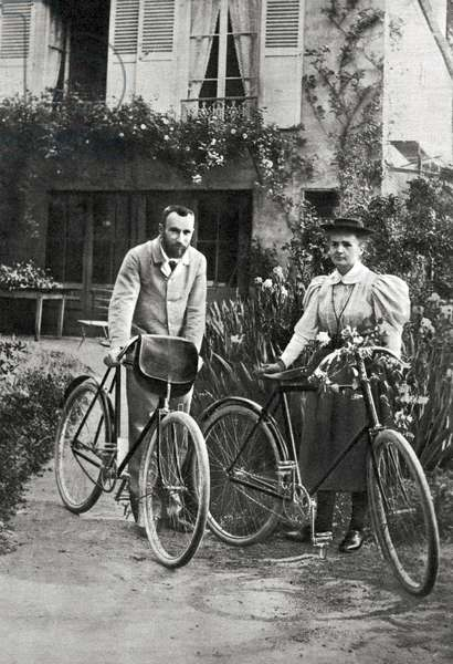 Pierre and Marie Curie in their garden, 1895 -