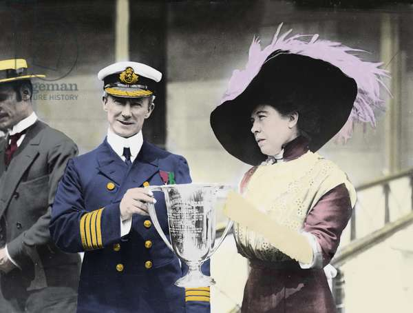 Portrait of Arthur Rostron (1869-1940), captain of the ship Carpathia, and Molly Brown survived the sinking of the Titanic, holding a cup of merite for their heroism during the disaster. Photography