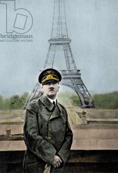 Adolf Hitler in Paris in 1943 against the background of the Eiffel Tower.