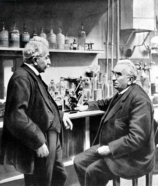 Portrait of the brothers Louis (1864 - 1948) and Auguste Lumière (1862 - 1954) in their laboratory. Photograph of the beginning of the 20th century.