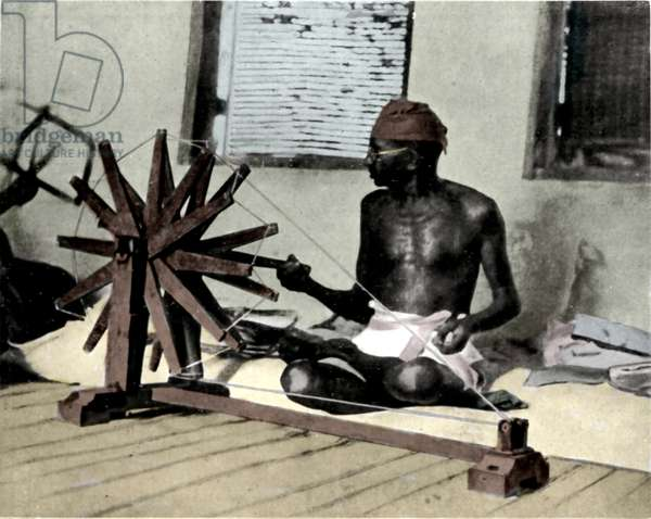 Portrait of political leader Mohandas Karamchand Gandhi (1869-1948) spinning to boycott British products in protest against the British authorities. Photography