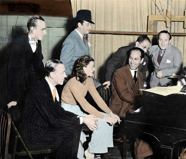 George Gershwin at the piano with Fred Astaire, Ginger Rogers, Hermes Pan, Mark Sandrich, Ira Gershwin and Nathaniel Shilkret on the set film 'Shall We Dance' by Mark Sandrich, 1937 (photo)