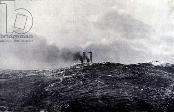 An American battleship covered by a huge wave in the Atlantic Ocean.