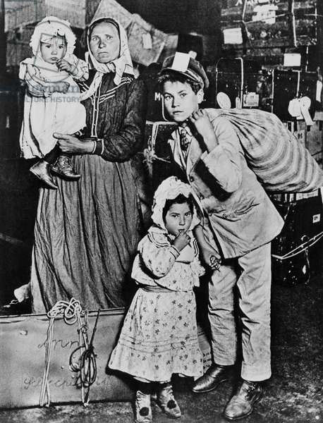 Immigrants arriving at Ellis Island in the early 20th century.