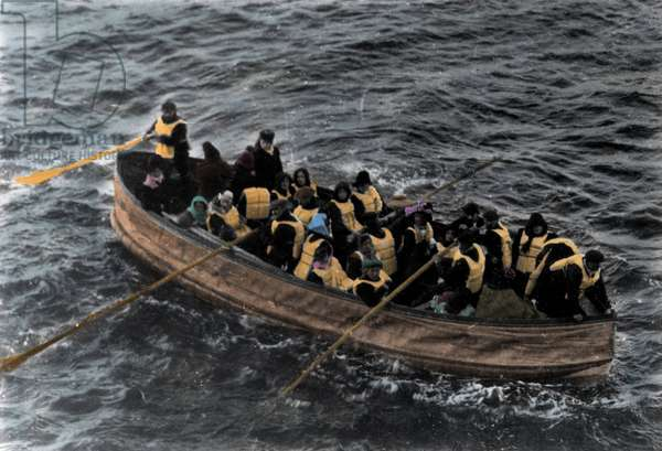 Photograph probably taken from the Carpathia of a lifeboat loaded with Titanic survivors during the shipwreck in April 1912.