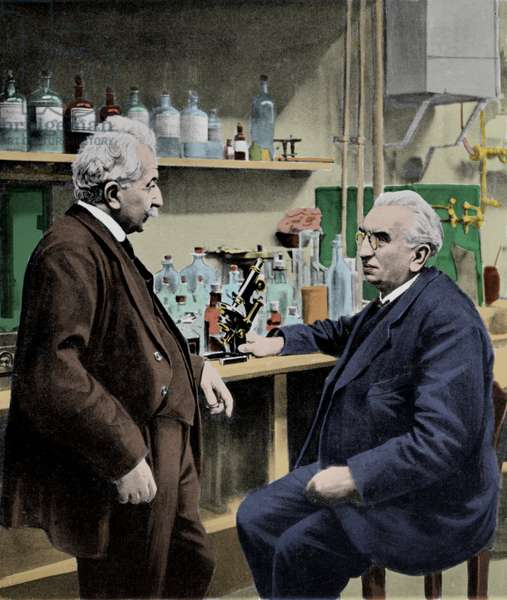 Portrait of brothers Louis (1864 - 1948) and Auguste Lumiere (1862 - 1954) in their laboratory. Photograph of the beginning of the 20th century.
