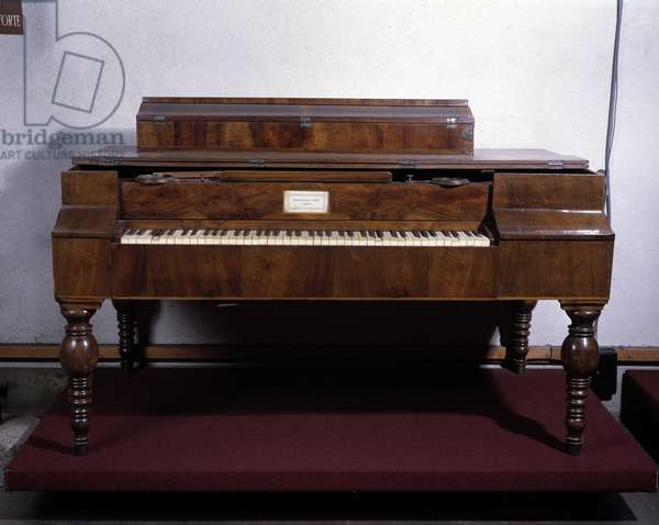 Pianoforte in walnut wood preserved in Bologna and manufactured by Raffaello Dondi, 19th century.
