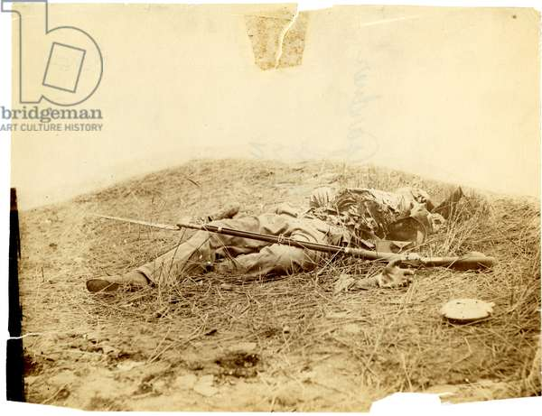 Dead Confederate soldier badly mutilated in field near Rose Woods, Gettysburg, 5 July 1863 (sepia photo)