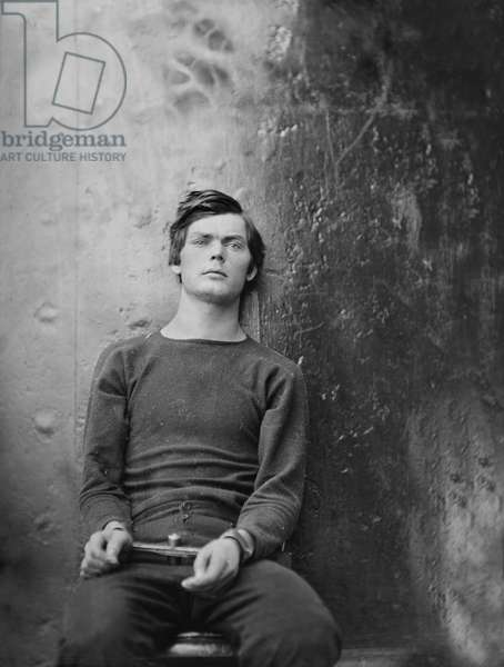 Lewis Powell, also known as Lewis Payne, Attacker of U.S. Secretary of State William H. Seward, and Conspirator in Assassination of U.S. President Abraham Lincoln, Seated and Manacled, Washington Navy Yard, Washington DC, USA, by Alexander Gardner, April 1865 1865 (b/w photo)