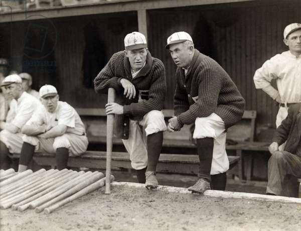 Grover Cleveland Alexander & Manager Pat Moran, in background are Joe Oeschger, Possum Whitted, & Milt Stock, Philadelphia Phillies, Bain News Service, 1915 (b/w photo)