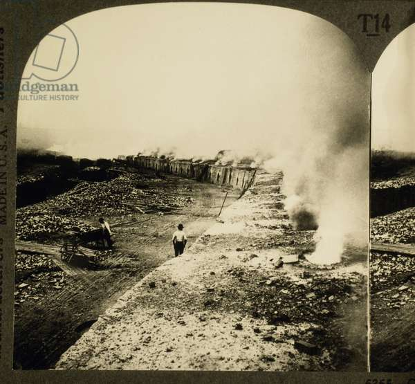 Workers loading coke onto railroad cars, Connellsville, Pennsylvania, USA, c.1905 (b/w photo)