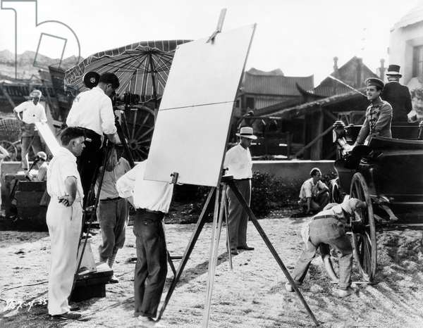 Director Clarence Brown, (left), John Gilbert, (in carriage), on-set of the Silent Film