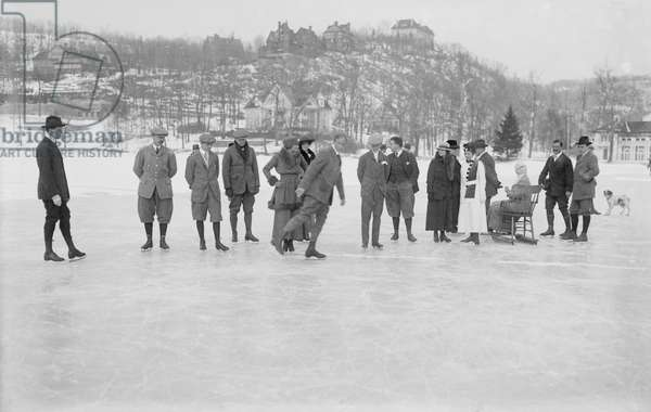Group of People Ice Skating on Lake, Tuxedo, New York, USA, Bain News Service, 1915 (b/w photo)