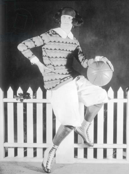 Women Dressed in Sports Attire and Holding Ball