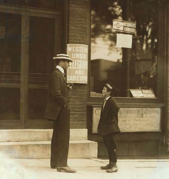13-year-old Western Union Messenger Boy Talking to Man outside Office, Usually Works from Noon to 10:30pm, Burlington, Vermont, USA, circa 1910