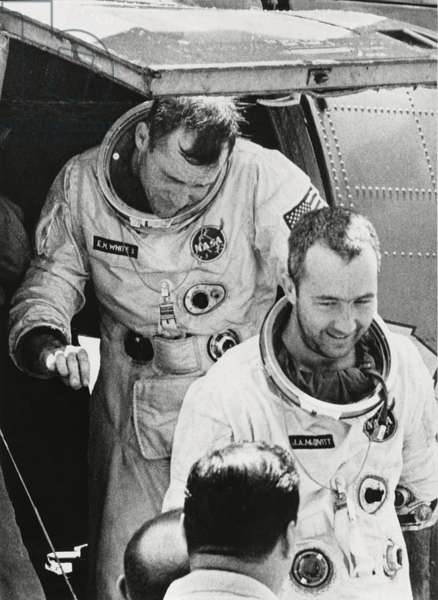 NASA Astronauts James McDivitt (front) and Edward White II Exiting Helicopter after Being Rescued from Ocean upon Completion of Gemini IV Space Mission, June 7, 1965