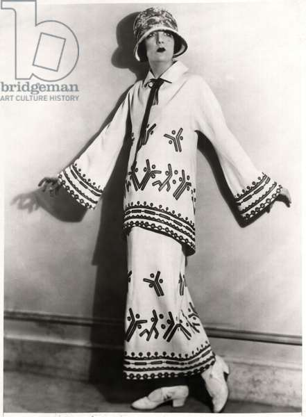 Fashionable Woman in Two-Piece Outfit of White Twill, Applique Motifs and Embroidery with Hat, Portrait, c.1922